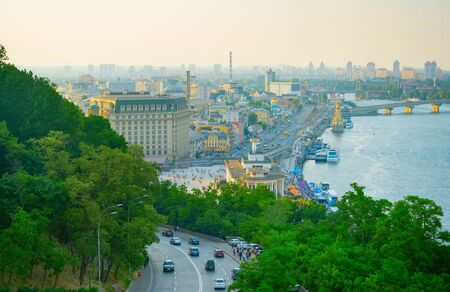 Skyline of Kiev at twilight. Podil, river Dnipro. Ukraine