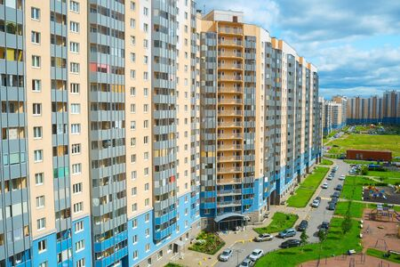 Inner yard among modern apartment buildings in residential district of Saint Petersburg, children playground, car parking, view from above, Russia