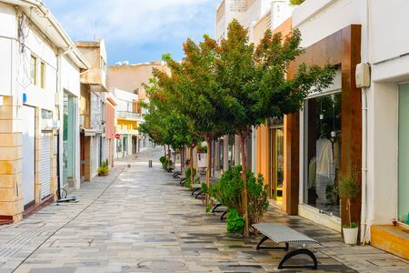 Shopping street in central touristic district of Paphos with green trees, Cyprus