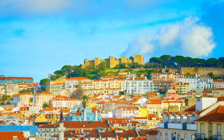 Skyline of Lisbon Old Town with Lisbon Castle on a top of a hill. Portugal