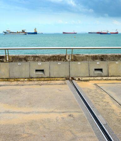 Singapore harbor. Industrial cargo ships in the background Zdjęcie Seryjne