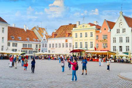 TALLINN, ESTONIA - JULY 14, 2019: Tourists at famous Town Hall Square in Tallinn, Estonia