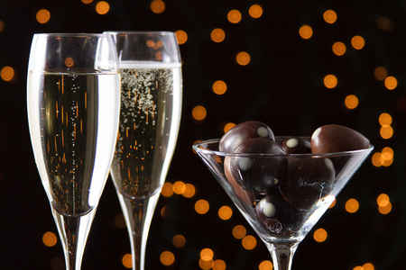 champagne truffles chocolate: flutes of champagne with truffles Stock Photo