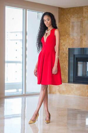 brazilian ethnicity: Portrait of a beautiful young black woman in red dress fashion outfit Stock Photo