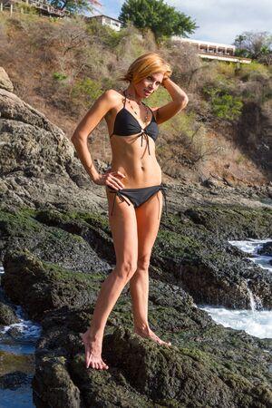 tanned girl: full length portrait of young beautiful tanned girl in bikini