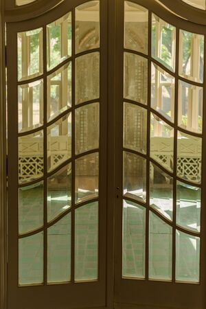 double glass: double glass paned front door to tile room