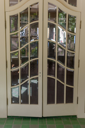 double glass: double glass paned front door from tile room