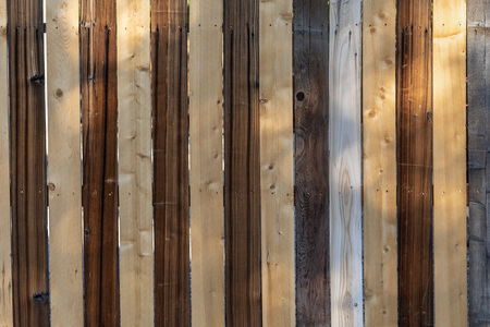 Weathered wood background surface. Wooden wall texture different colored planks. Imagens