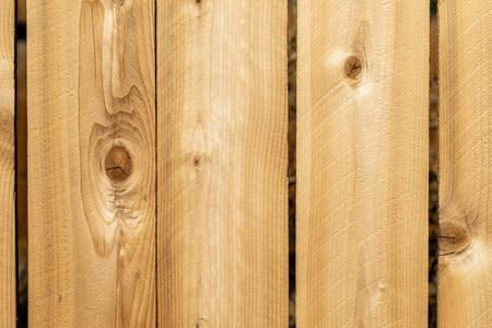 Close up weathered wood background surface. New wooden wall texture planks with knots. Imagens