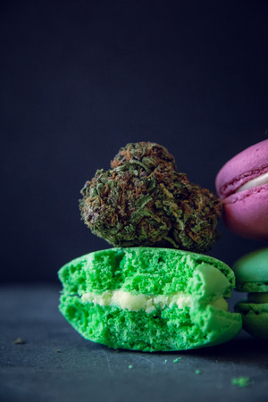 Vertical Marijuana Edibles With Cannabis Nugs On Dark Slate Background. Selective Focus With Copy Space.