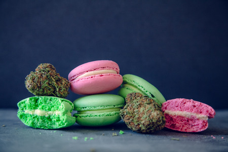 Marijuana Edibles With Cannabis Nugs On Dark Slate Background. Selective Focus With Copy Space. Imagens