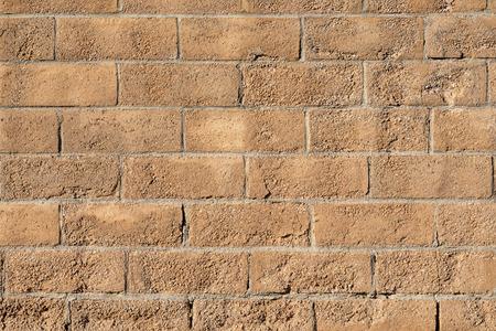 Concrete brown brick block background.