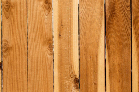 Close up weathered brown wood background surface. Wooden wall texture rustic planks with knots.