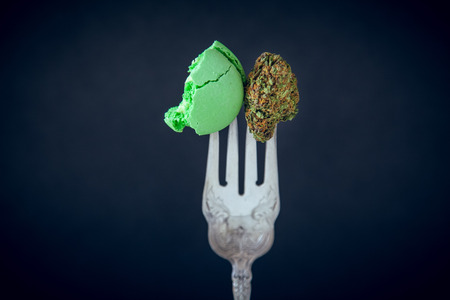 Marijuana Edibles On Vintage Silver Fork With Cannabis Buds. Selective Focus With Copy Space On Dark Background. Imagens