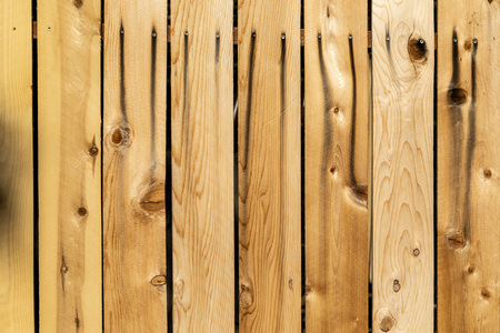 Weathered brown wood background surface. New wooden wall texture planks with knots.