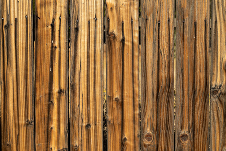 Weathered brown wood background surface. Wooden wall texture rustic planks with nails.