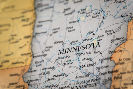 Closeup Selective Focus Of Minnesota State On A Geographical And Political State Map Of The USA.