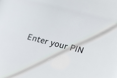 Close up of Enter your pin message on a smart phone screen.