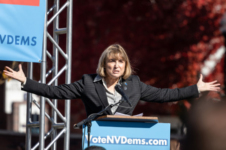 RENO, NV - October 25, 2018 - Kate Marshall with hands up at a political rally on the UNR campus.