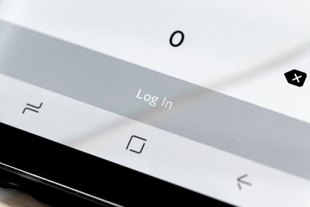 Close up of Log In message on a smart phone screen.