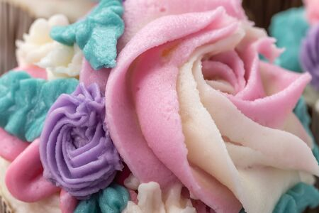 Macro Floral cupcakes on wood background