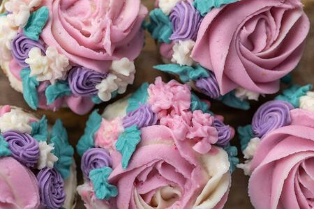 Top down Close Up Floral cupcakes on wood background