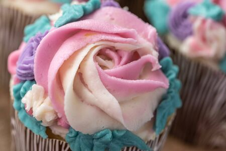 Close Up Floral cupcakes on wood background