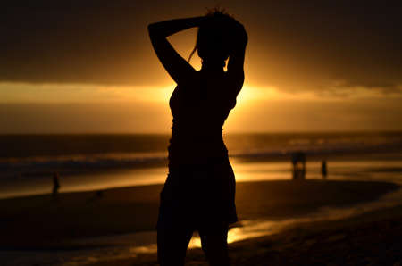 legian: Woman Silhouette on Bali Beach Sunset
