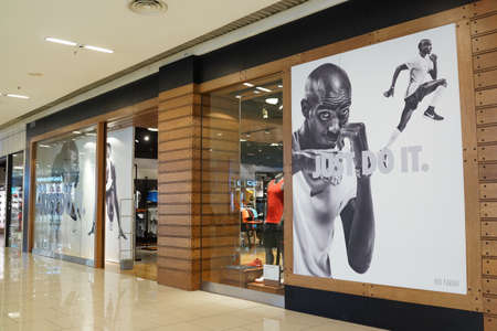 PENANG, MALAYSIA - NOVEMBER 27, 2017: Nike storefront in a shopping mall. Nike is an American multinational corporation that designs, manufacturing, marketing and sales athletic shoes and apparel. Editorial