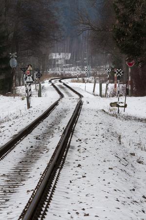 railroad tracks in winter landscape photo