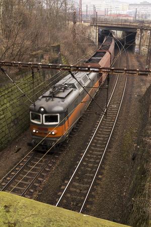 long haul journey: railroad tracks leading out onto a steel bridge