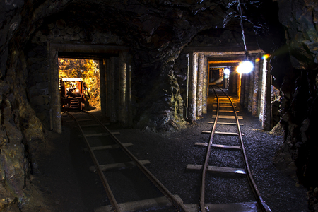 mining gold: Old mine tunnel with around