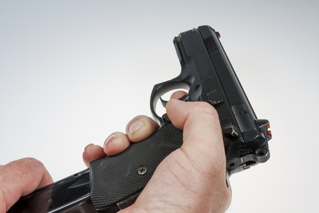 shooters: gun and bullets in the shooters hand Stock Photo