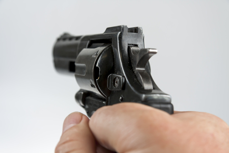 Hand holding a large black revolver Stock Photo