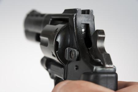 hand gun: Hand holding a large black revolver Stock Photo