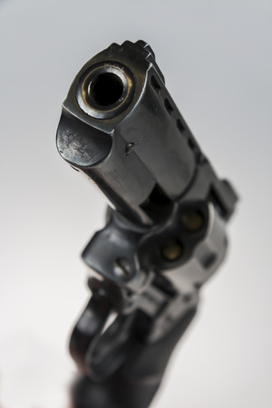 violence and trigger: Hand holding a large black revolver Stock Photo