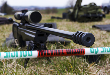 aims: Military sniper aims at a target