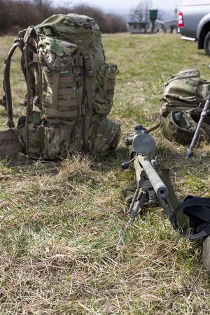 sniper: Military sniper aims at a target