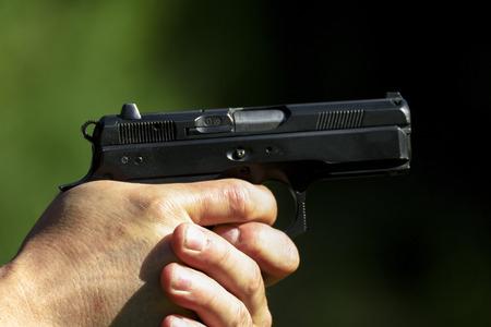 practicing: Man practicing shooting with a gun