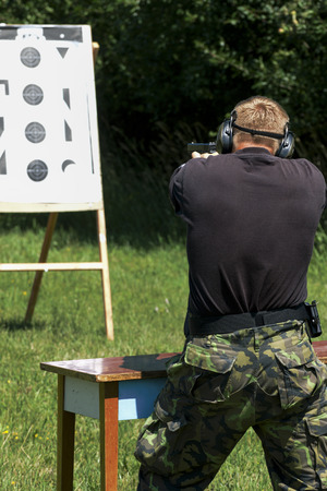 aiming: Police shooting practice at a shooting range Stock Photo