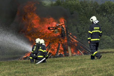 Firefighters extinguish fire fire vehicle