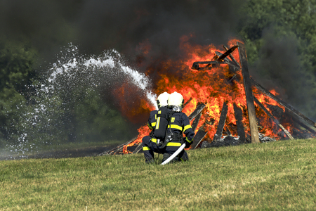 extinguish: Firefighters extinguish fire fire vehicle