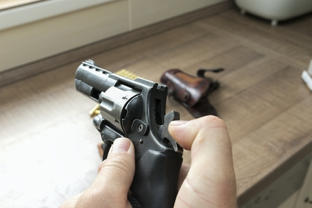 Man reloading an ammunition revolver Stock Photo