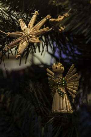 beautiful ornaments made of straw on a Christmas tree Stock Photo