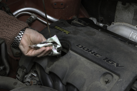 the car mechanic fixes the car engine by tools