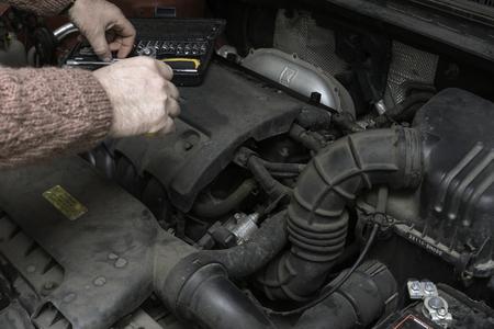 car mechanic fixes the car engine