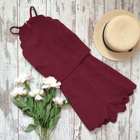 Burgundy dress on a wooden background
