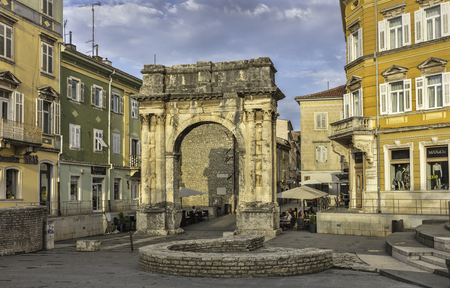 The Triumphal Arch of the Sergii in Pula with ruins of defensive towers, Croatia Editorial