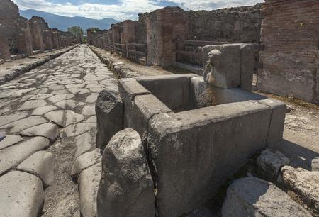 Roman fountain on the street in Pompeii, Italy