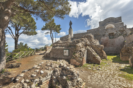 The statue of Virgin Mary with Jesus and church on the ruins of Tiberius Villa Jovis on island Capri, Italy